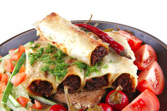Cannelloni with tomato cherry Stock Photos