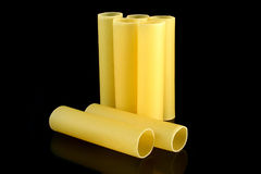 Cannelloni tubes. Cannelloni pasta tubes on a black background Stock Images