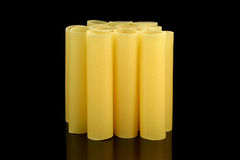 Cannelloni tubes - front view. Cannelloni pasta tubes on a black background Stock Image