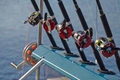 Cannes à pêche et ligne de pêche de bobines Images libres de droits