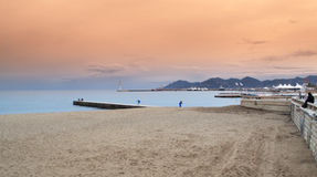 Cannes beach at sunset Stock Images