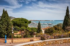 Cannes City on French Riviera. City of Cannes on French Riviera in France, Le Suquet hill view to sea and port Royalty Free Stock Photo