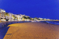Cannes` Croisette`s beach at sunset, view over line of luxury ho Stock Photos