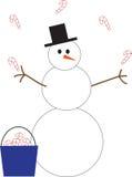 Cannes de sucrerie de jonglerie de bonhomme de neige Photographie stock libre de droits