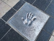 Cannes festival, Hand Prints Photos. Handprint of Lucas at the Esplanade Georges Pompidou in the city Cannes, French Riviera, Provence Alpes Côte d& x27;Azur stock photo