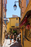 Cannes, France - August 05, 2016: road in the old town of Cannes with unidentified people. Cannes, at the French Riviera, known fo. Cannes, France - August 05 Royalty Free Stock Image