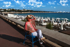 CANNES, FRANCE -  JULY 5, 2015. Woman relaxing in chair on Crois Royalty Free Stock Photos