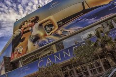 Film festival in cannes. CANNES, FRANCE - 7th May 2018 - Facade of the Palais des Festivals with the billboard of the 71 edition of the Cannes Film Festival royalty free stock photography