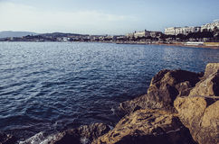 Cannes panorama from rock shore Stock Photos