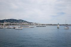Cannes, sea, vehicle, harbor, marina. Cannes is sea, marina and river. That marvel has vehicle, boat and ferry and that beauty contains harbor, passenger ship royalty free stock photos