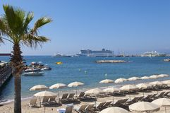 Cannes waterfront view from the promenade. Cannes beachfront seaview of anchored cruise ships near the port royalty free stock photography