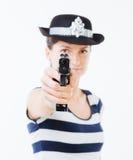 Cannette de fil de femme visant l'arme à feu Images stock