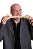Cannibal man. Elegant cannibal men eat bone Royalty Free Stock Image