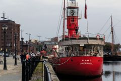 Canning Dock, Liverpool. LIVERPOOL, GREAT BRITAIN - SEPTEMBER 13, 2014: Red ship moored at Canning Dock as a fun place in the evening royalty free stock photo