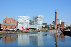 Canning Dock, Liverpool. The Pumphouse and city buildings seen across Canning Dock, Liverpool, Merseyside, England, UK, Western Europe Royalty Free Stock Images