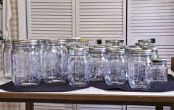 Canning Jars. Time for harvesting and canning garden produce, the canning jars are ready to be sterilized and filled Stock Photos