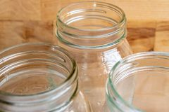 Canning jars against wood background royalty free stock image