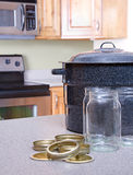 Canning jars and supplies in a kitchen Royalty Free Stock Photos