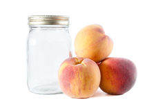Canning Peaches Beside A Glass Jar Stock Photo