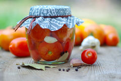 Canning tomatoes. Fresh vegetables and spices. cooking the recipe royalty free stock photo