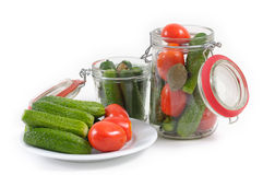 Canning tomatoes and cucumbers Stock Photography