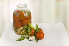 Canning tomatoes in glass bottles Royalty Free Stock Image