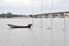 Busy fisherman at matla river canning