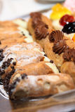 Cannoli bar and eclair. Served on a dessert plate Stock Image