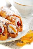 Cannoli and candied oranges. Stock Photography