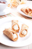 Cannoli tubes pastry on the plate Stock Photos