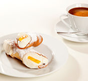 Cannolo with coffee cup Stock Photography