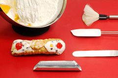 Cannolo siciliano and confectioner utensils Royalty Free Stock Image