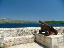 Cannon. Old costal defense fortifications in Korcula, Croatia royalty free stock photo