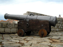 Cannon. Old cannon on city walls stock photo