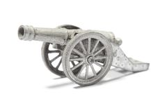 Cannon. Old metallic toy cannon isolated on white stock photos