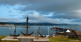 Cannon and Anchor Monuments at public park overlooking the Atlantic and Wicklow Ireland Harbor. Under overcast skies stock photo