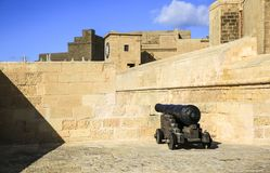 A cannon of the Ancient Citadel in Gozo. A cannon inside the walls of the Ancient Citadel in Gozo Royalty Free Stock Photos