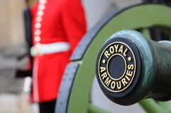 Cannon And Guard At The Royal Armories At The Tower Of London, London, UK Stock Photo