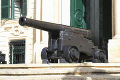 Cannon before Auberge de Castille Stock Photos