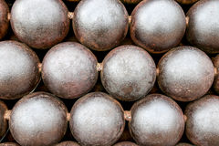 Cannon Balls arranged in a pile background Stock Images