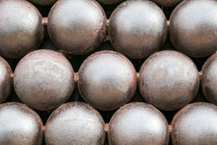 Cannon Balls arranged in a pile background Royalty Free Stock Photo