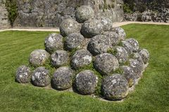 Cannon Balls at Pevensey Castle in East Sussex. Old cannon balls inside the historic ruin of Pevensey Castle in East Sussex, UK. It is a medieval castle and royalty free stock photo