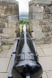 Cannon between battlements of  castle Stock Images