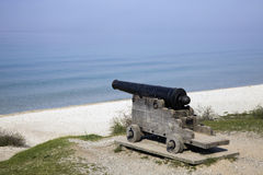 Cannon on the beach Royalty Free Stock Photo