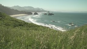 Cannon Beach, Oregon dolly shot 4K. UHD. Cannon Beach from Ecola State Park, Oregon, United States. 4K UHD stock video footage