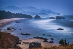 Cannon Beach & Fog. Photo of the panoramic view of the cannon beach in a foggy day stock photos