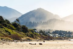Cannon Beach Oceanfront Vacation Homes. Oceanfront vacation homes along Cannon Beach Oregon Coast by Pacific Ocean Stock Photos