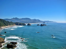 Cannon Beach in Oregon. Scenic view of Cannon Beach and blue sea viewed from Ecola Park, Oregon, U.S.A Stock Photo