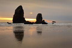 Cannon Beach Pinnacles Sunset. Cannon Beach pinnacles at sunset, Pacific Ocean. Oregon coast. United States royalty free stock photos