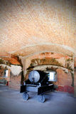 Cannon in Brick Gun Room. Old historical bunker with immobilized cannon inside brick arches of a Fort in Key West Florida. Zachary Taylor State Park. Gun rooms Royalty Free Stock Image